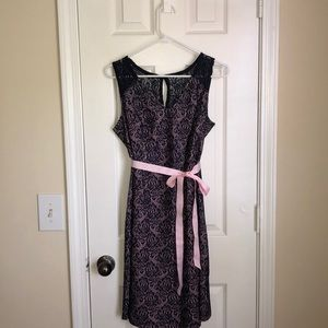 Sleeveless Pink/navy lace overlay maternity dress.